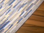 Carpet Sternstein made to measure blue-yellow-gray speckled